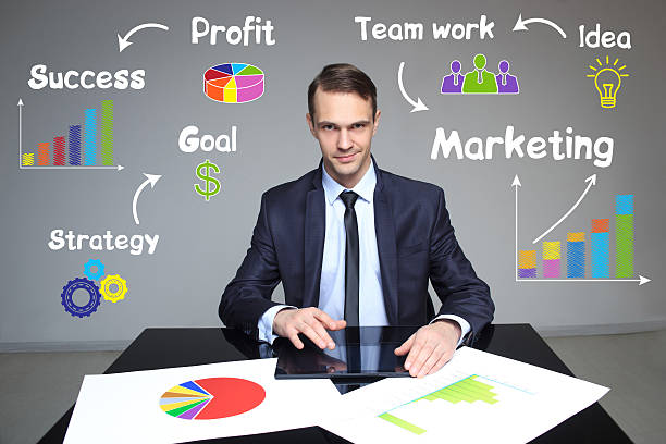 businessman showing growth rates in the chart. work presentation - rates stock photos and pictures