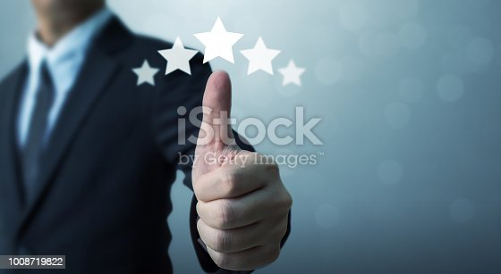 1133580311 istock photo Businessman showing hand sign thumb up and five star symbol to increase rating of company, The excellence of the business or service concept 1008719822