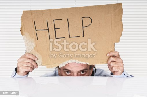 istock Businessman Showing Help Sign 155134821