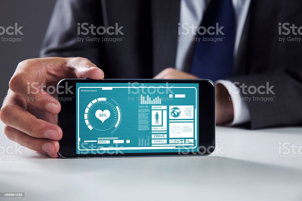Businessman showing his smart phone screen stock photo