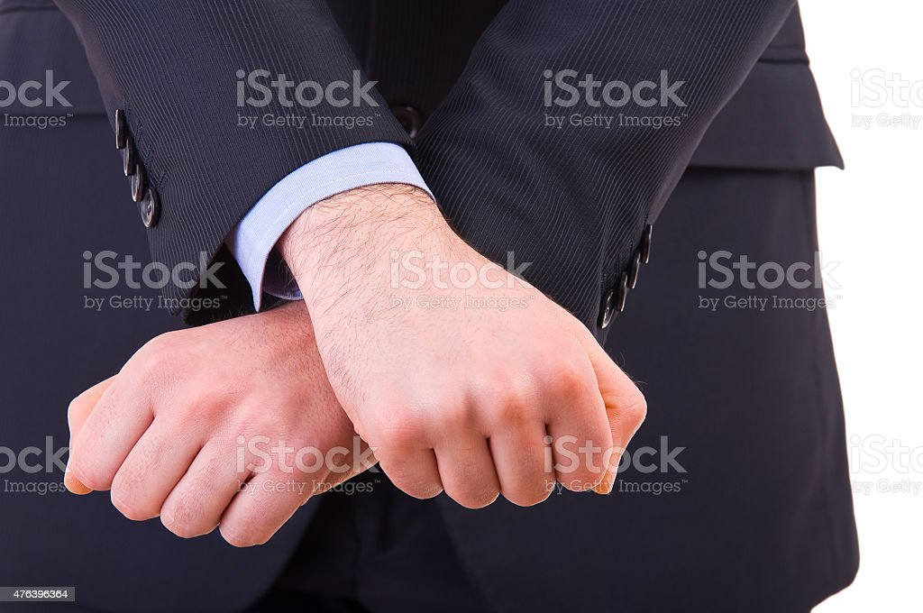 Businessman showing jail gesture with his hands. stock photo