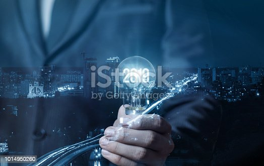 istock Businessman showing light bulb with glowing 2019. 1014950260