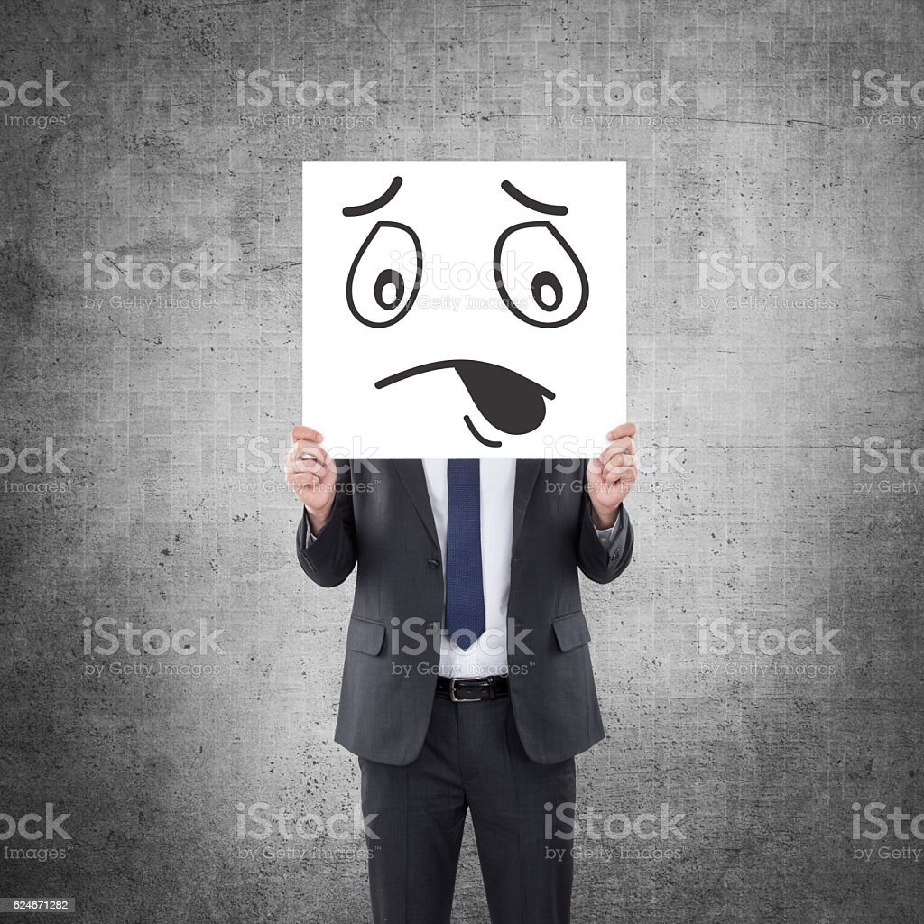 Businessman showing placard with shocked facial gesture. stock photo