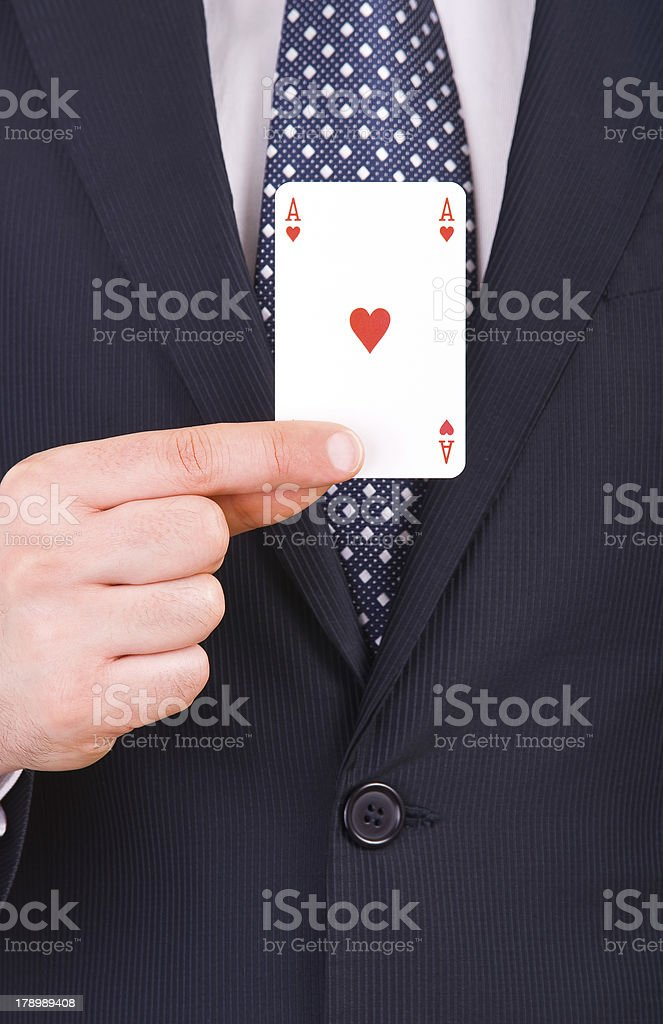 Businessman showing playing card. stock photo