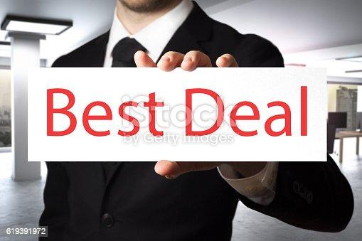businessman in modern office showing sign best deal