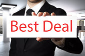 businessman showing sign best deal
