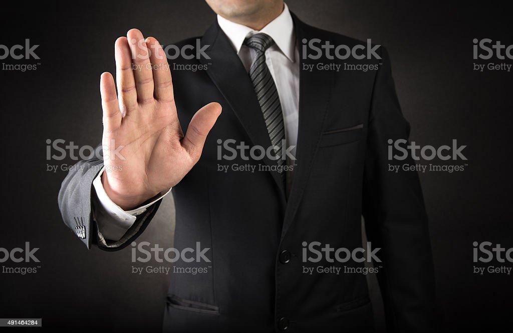 Empresário mostrando Sinal de Parar - foto de acervo