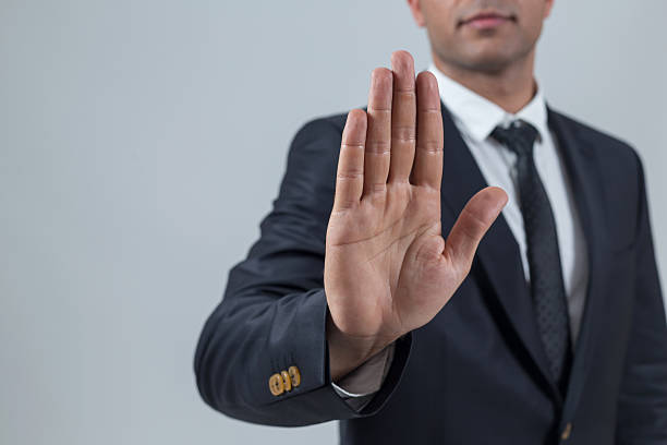 Businessman showing stop with hand Businessman showing stop with hand rejection stock pictures, royalty-free photos & images