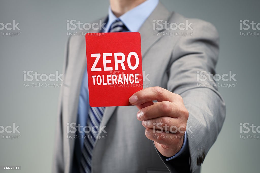 Businessman showing the zero tolerance red card stock photo