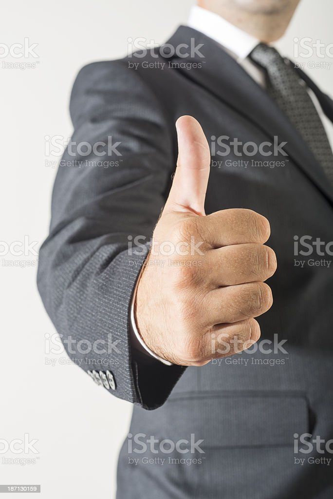 Businessman showing thumbs up royalty-free stock photo