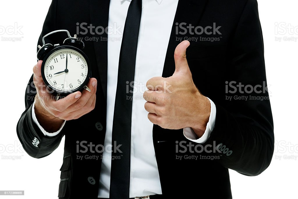 Businessman showing thumbs up stock photo