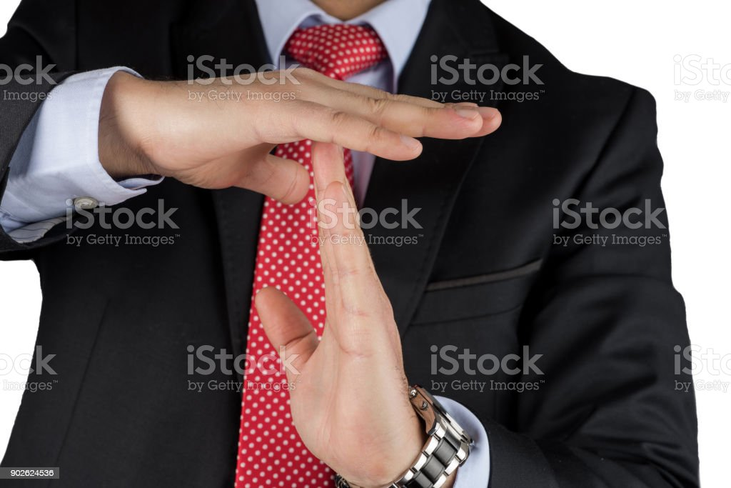 Businessman Showing Time Out Hand Sign stock photo