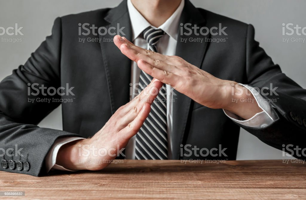 Businessman showing time-out gesture, body language stock photo