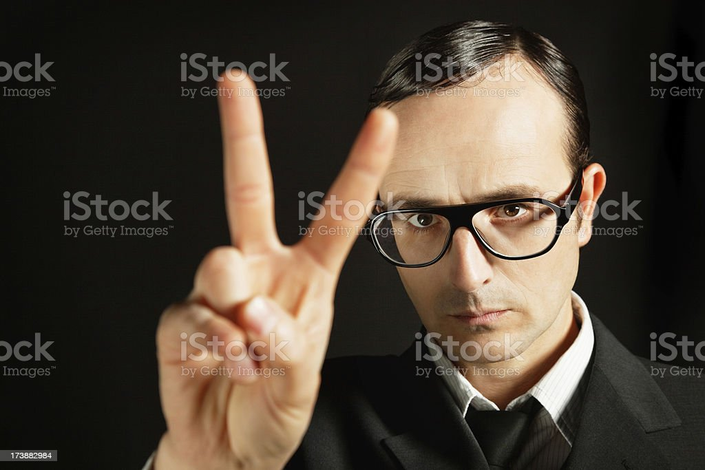 businessman showing victory sign royalty-free stock photo