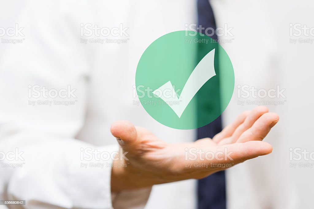 businessman showing virtual approved check mark stock photo