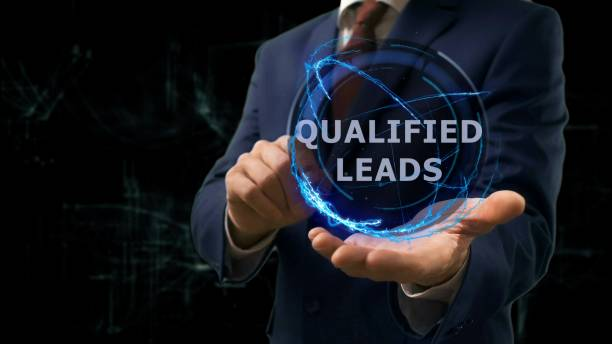 businessman shows concept hologram qualified leads on his hand - deaden stock pictures, royalty-free photos & images