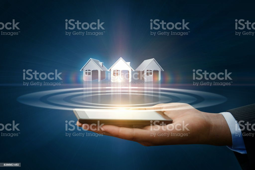 Businessman shows houses. stock photo