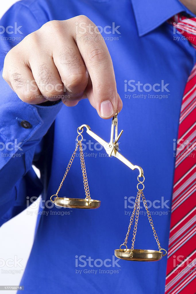 Businessman Shows Scales royalty-free stock photo