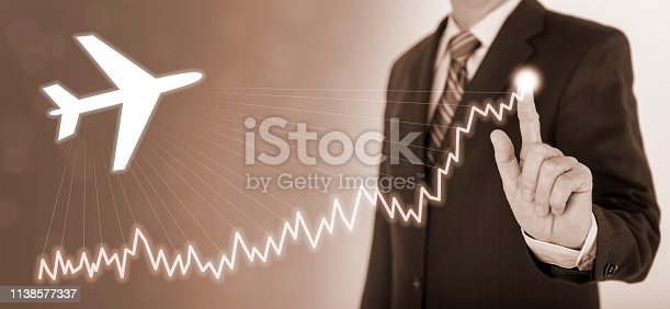 istock businessman shows success with chart and airplane 1138577337