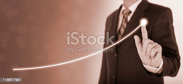 istock businessman shows success with chart 1138577951