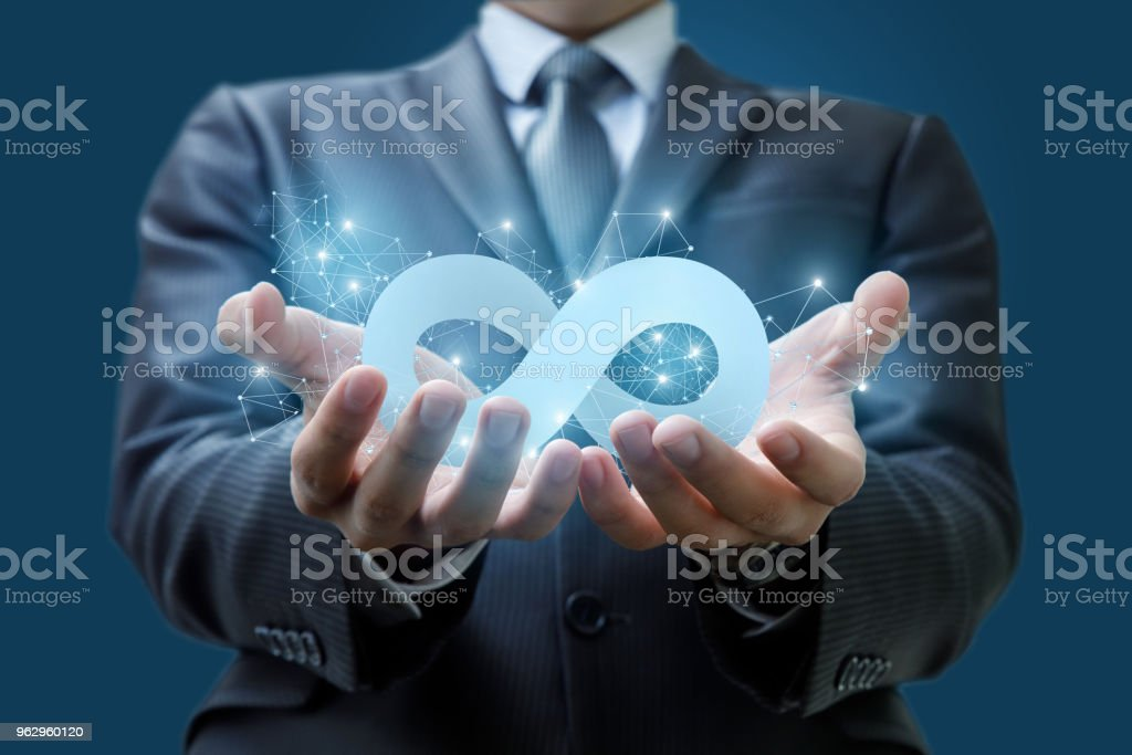 Businessman Shows The Infinity Symbol Stock Photo More Pictures Of