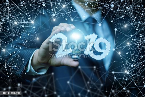 istock Businessman shows the inscription in 2019. 1014950230