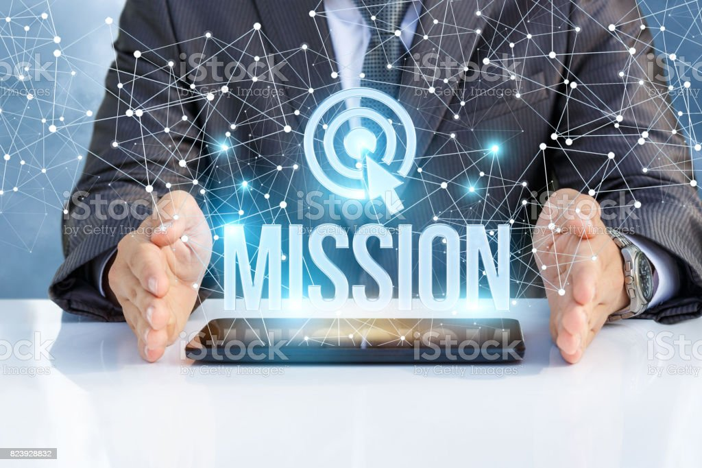 Businessman shows the word mission . stock photo