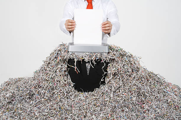 businessman shredding documents - shredded paper stock photos and pictures