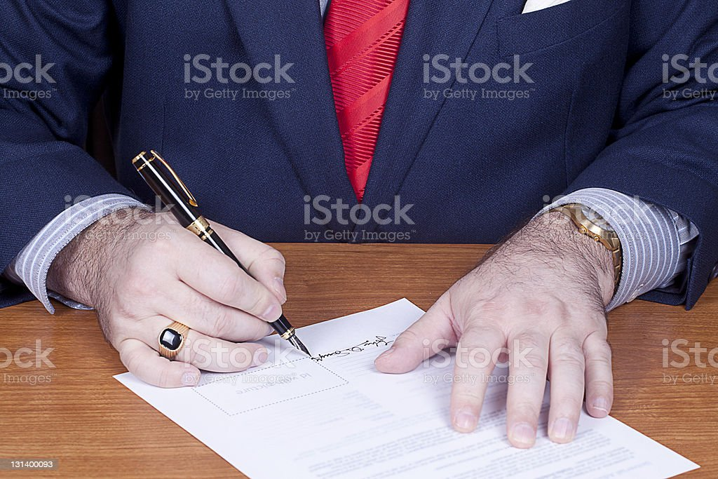 Businessman signing a contract. royalty-free stock photo