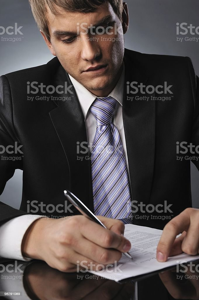 Businessman signing a contract royalty-free stock photo