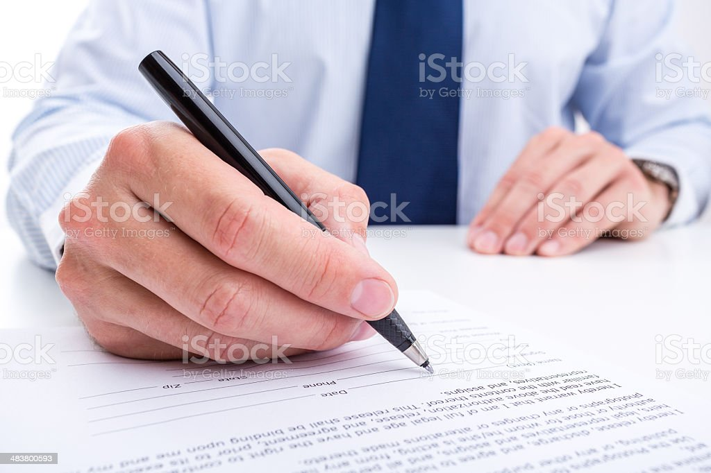 Businessman signing a document. royalty-free stock photo