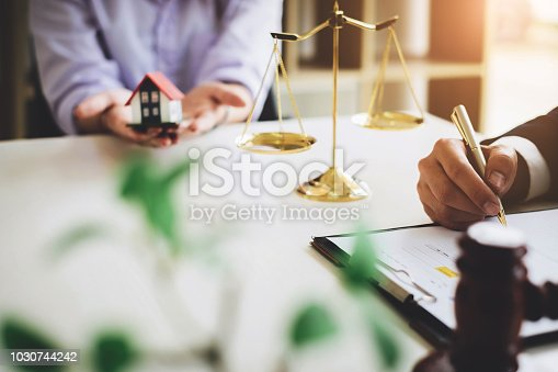 Businessman signing agreement contract for buying house blurred background. Bank manager concept.
