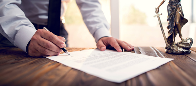 Businessman Signing An Official Document Stock Photo - Download Image Now