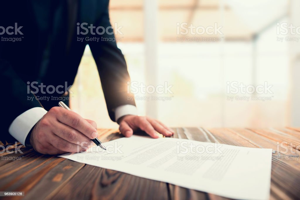 Businessman Signing An Official Document - Royalty-free Adult Stock Photo