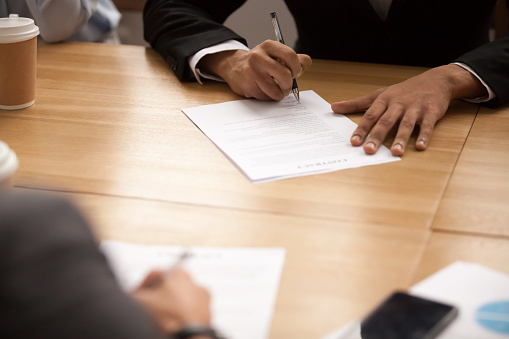 843533912 istock photo Businessman signing business contract at meeting, making partnership deal concept 924520212