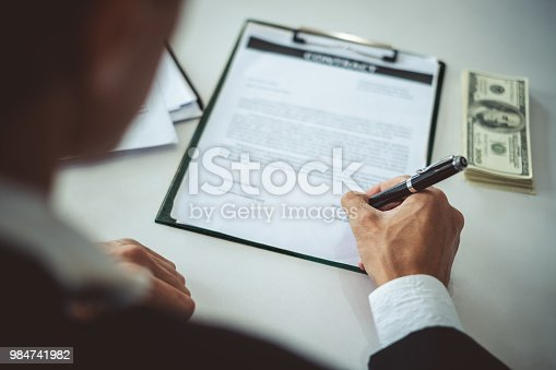 638881988istockphoto Businessman signing contract for bank money loaning 984741982