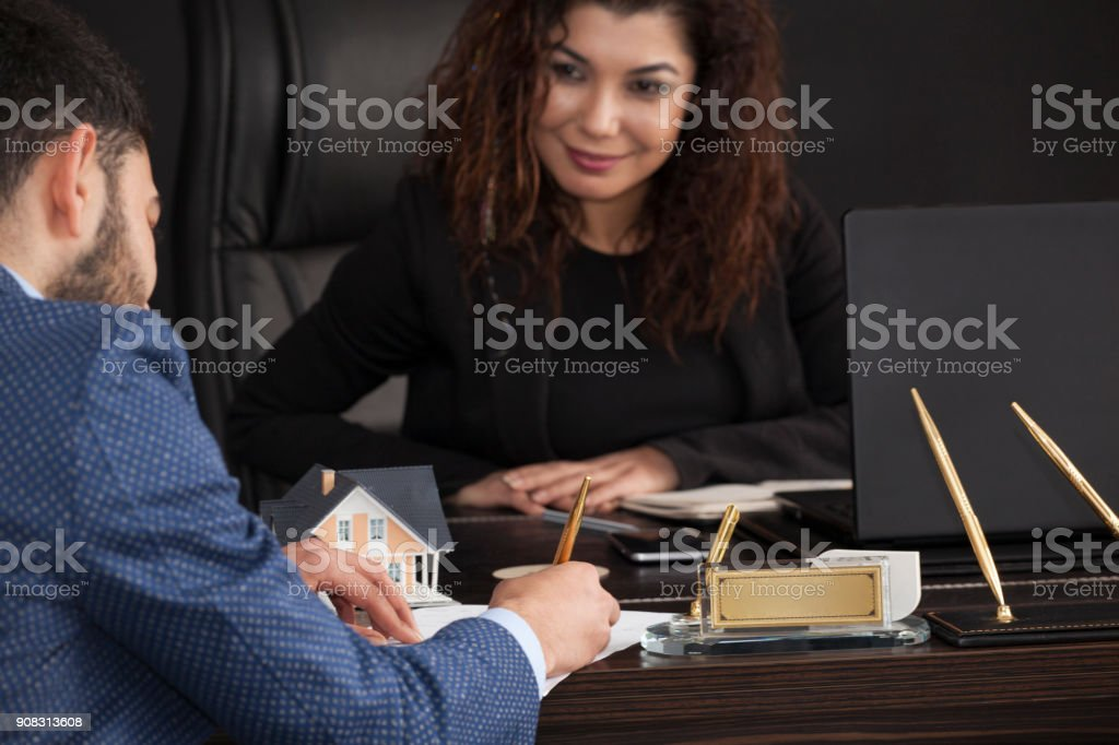 Businessman signing contract in the office stock photo