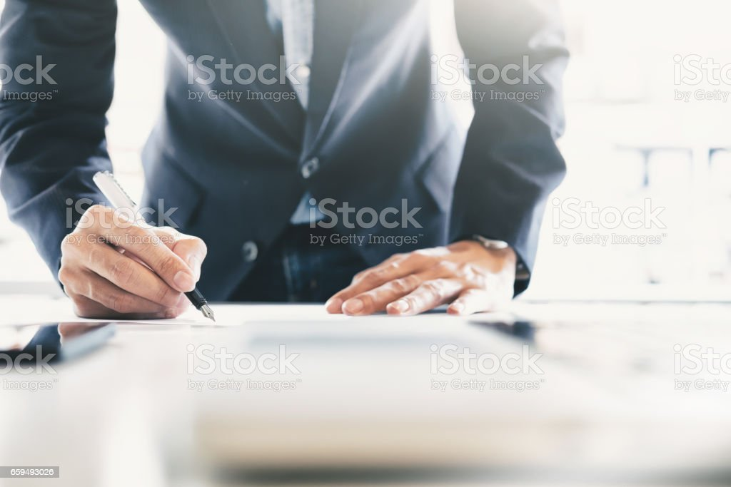 Businessman signing contract making a deal. stock photo