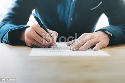 659493026 istock photo Businessman signing contract making a deal. 937133598