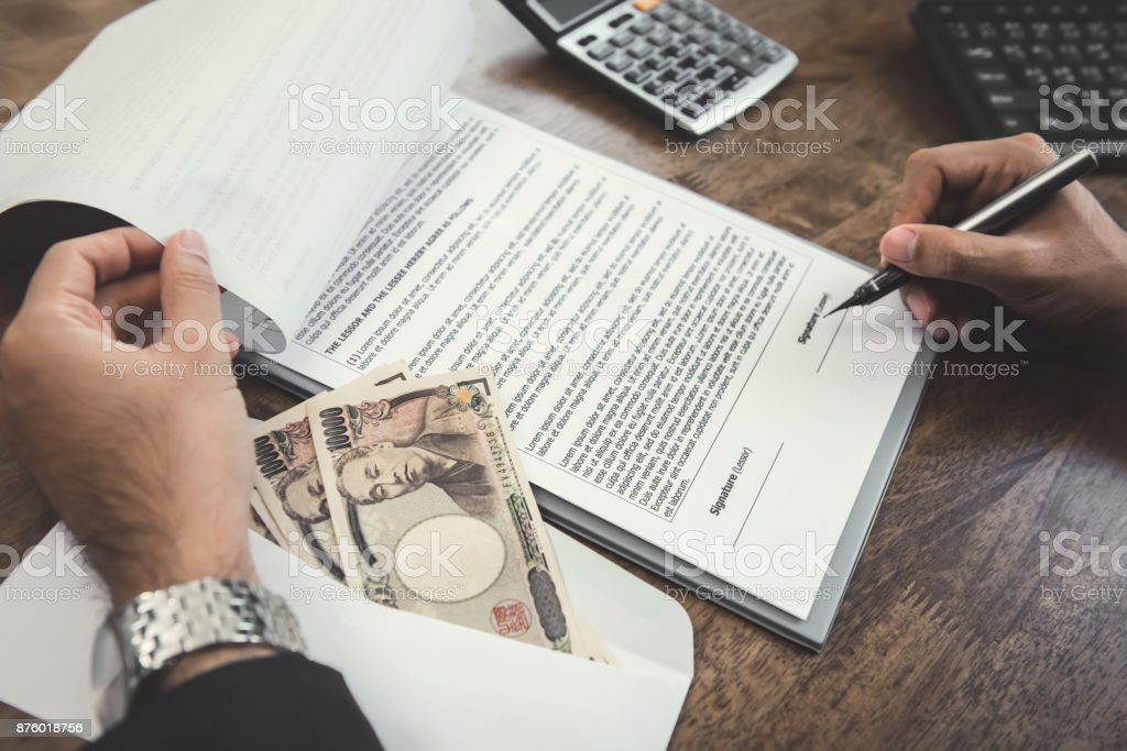 Businessman signing contract with japanese yen money stock photo