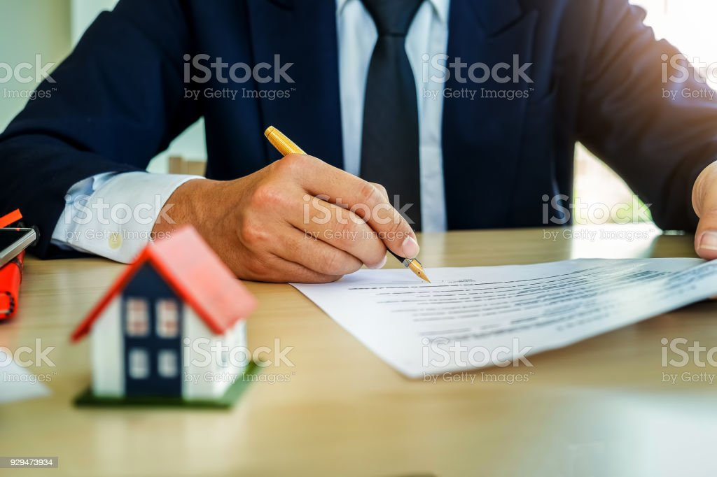 Businessman Signing Document Concept Focus On Male Hand Holding Pen - Signing legal documents