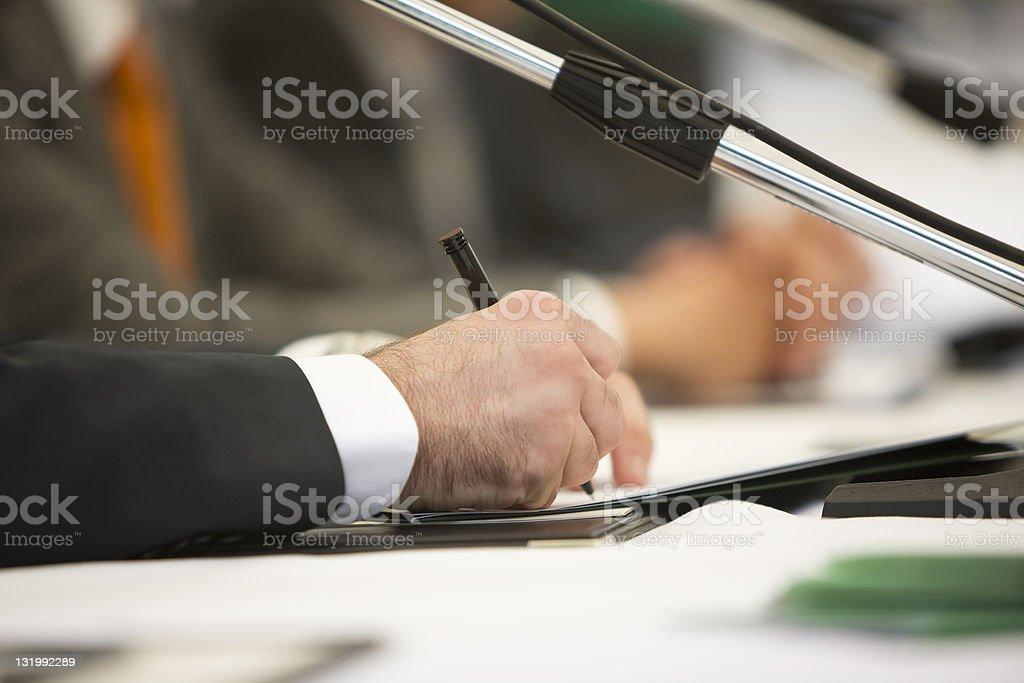 Businessman signing document royalty-free stock photo
