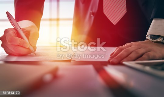 istock businessman signing documents 512543170