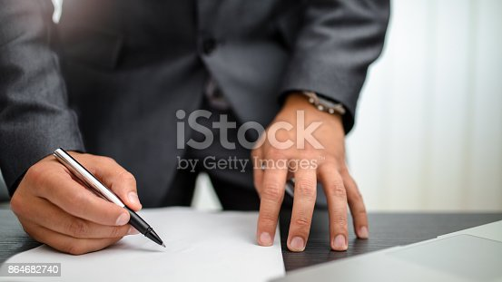 659493026 istock photo Businessman signing documents 864682740