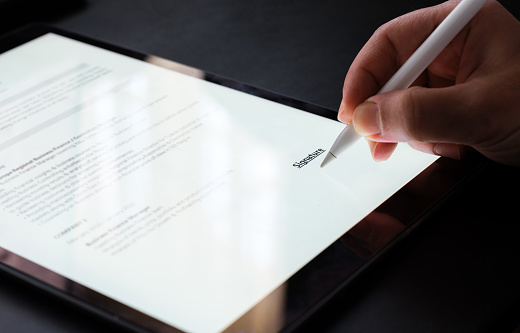 Businessman Signing Electronic Contract On Digital Tablet