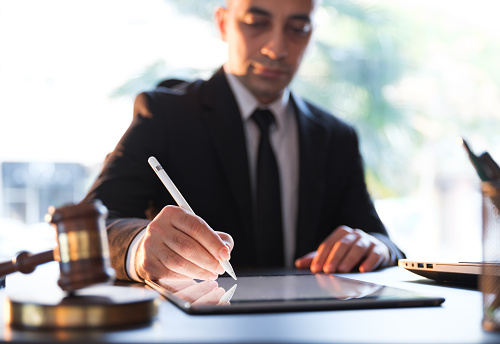 Businessman Signing Electronic Legal Document On Digital Tablet