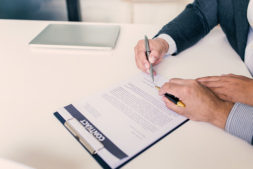 843533912 istock photo Businessman signing of investment buying and selling real estate contract. 1189568031