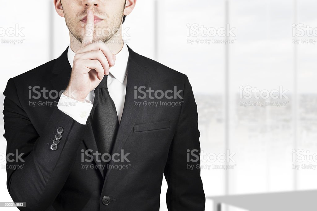 businessman silent quiet gesture stock photo