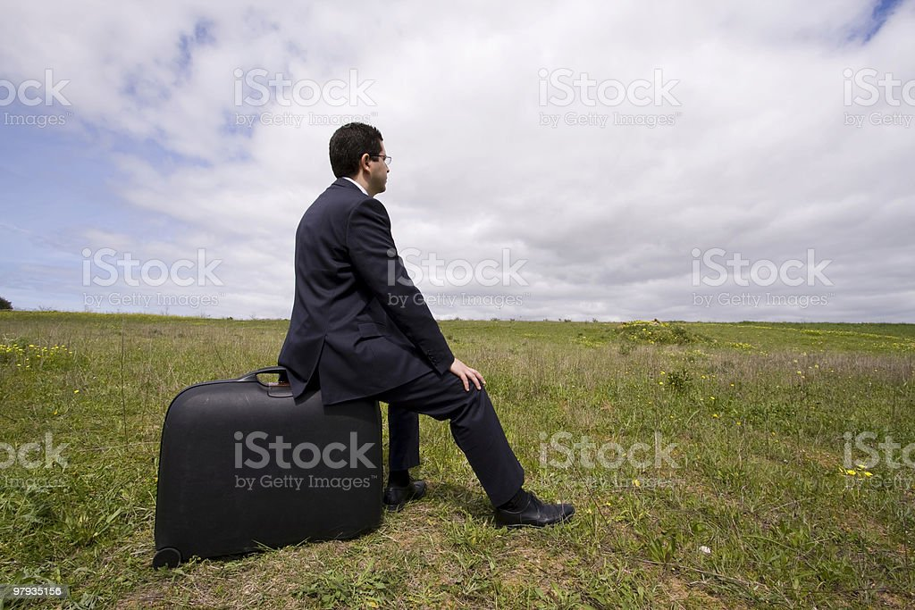 businessman sit in his baggage royalty-free stock photo