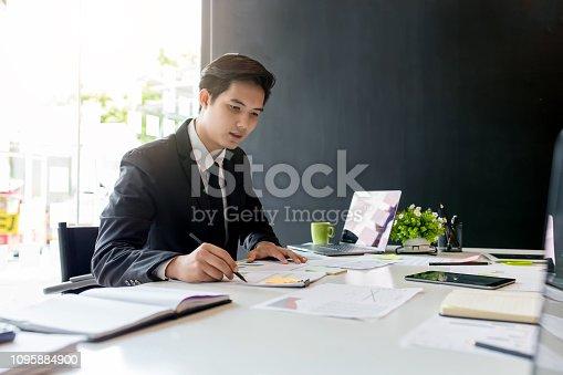 istock Businessman sitting analyze document information in the workplace. 1095884900